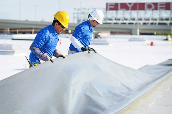 Mid-South Roof Systems Team Members atop a roof working using Commercial Roof Materials