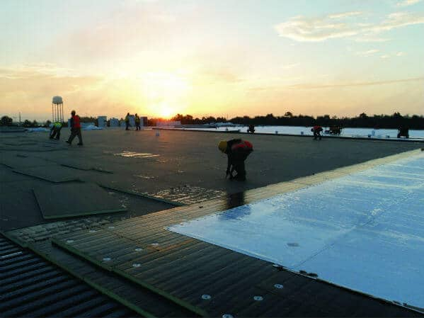 Mid-South Roof-Systems team members Protect Roof from UV light