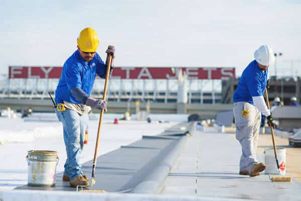Mid-South Roof systems team members atop Delta rooftop working on roof lifespan