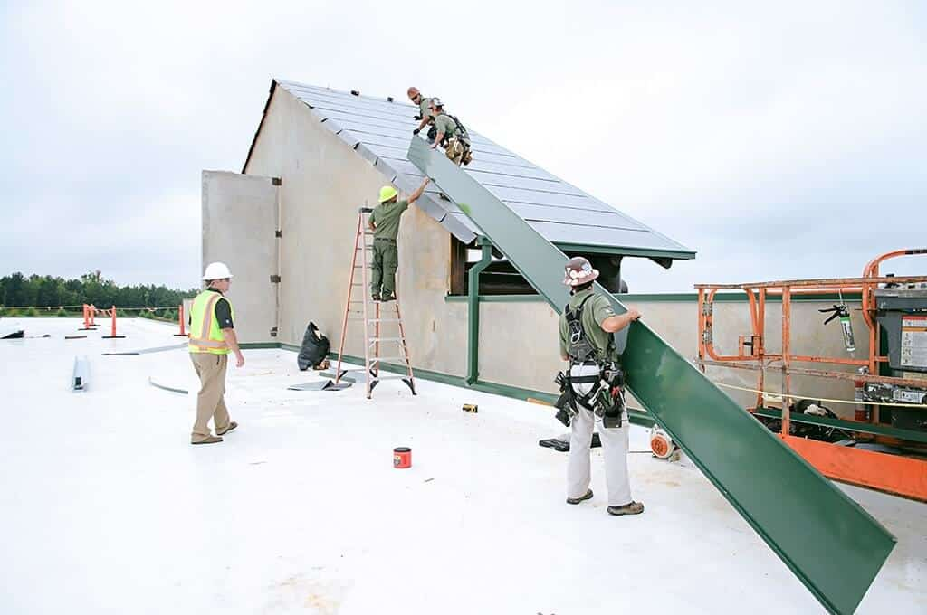 Mid-South Roof Systems Team Members atop a roof working