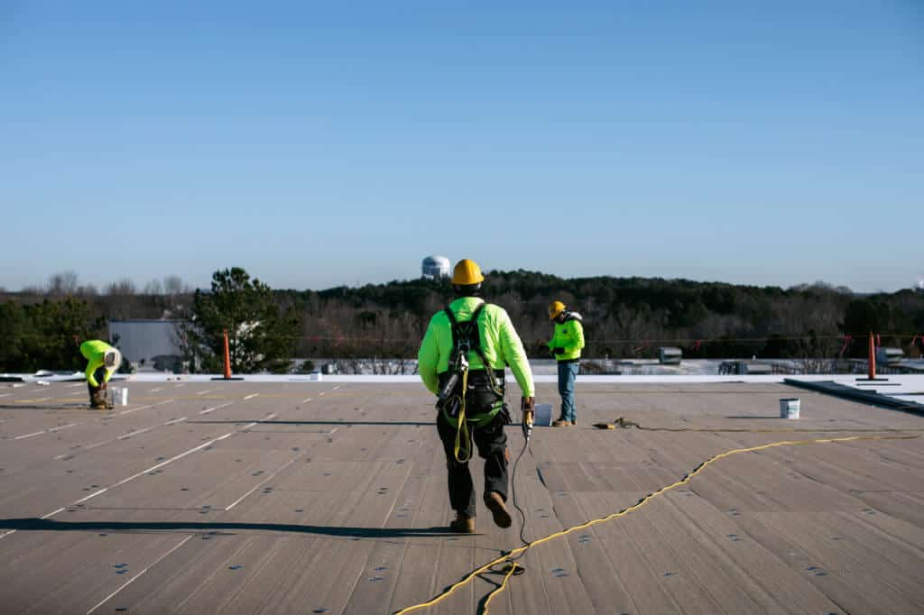 commercial roofers on top of flat roof